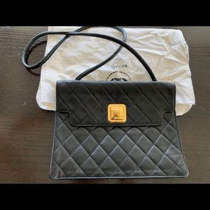 Vintage Chanel Quilted Flap Bag in black.